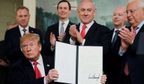 President Trump signing papers for Golan Heights